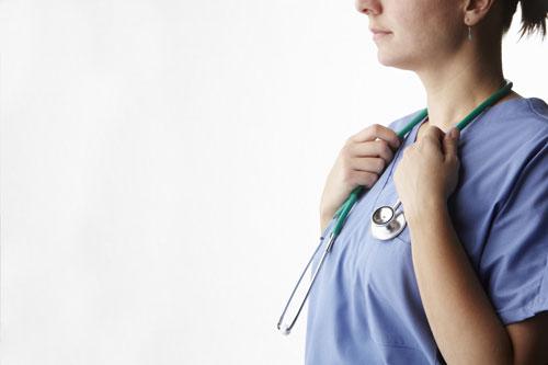 Female doctor holding stethoscope