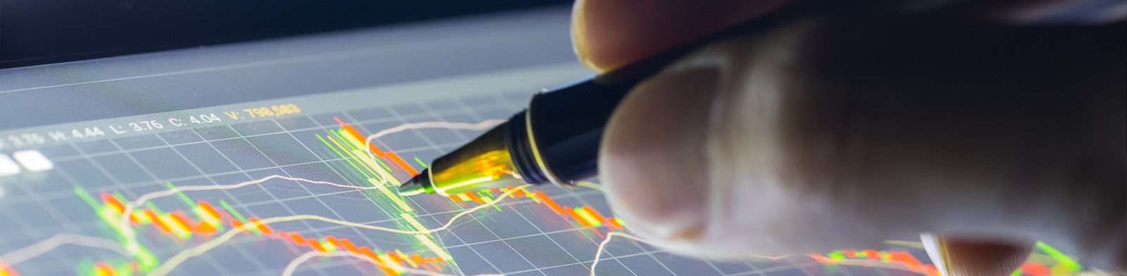 Financial analysis graphs on an electronic tablet
