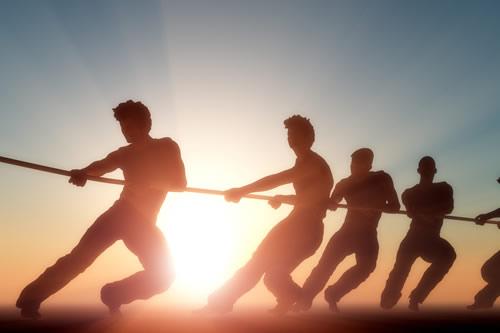 Teamwork in a tug of war