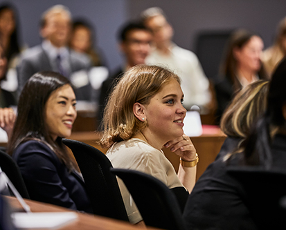 Young woman sitting in a lecture