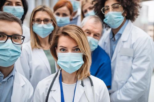 Doctors line up in surgical masks