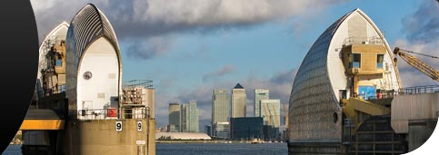 Canary Wharf seen through the Thames Barrier