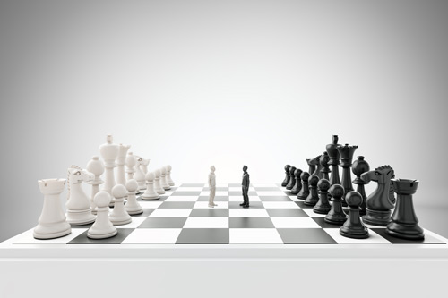 two men standing on a chessboard