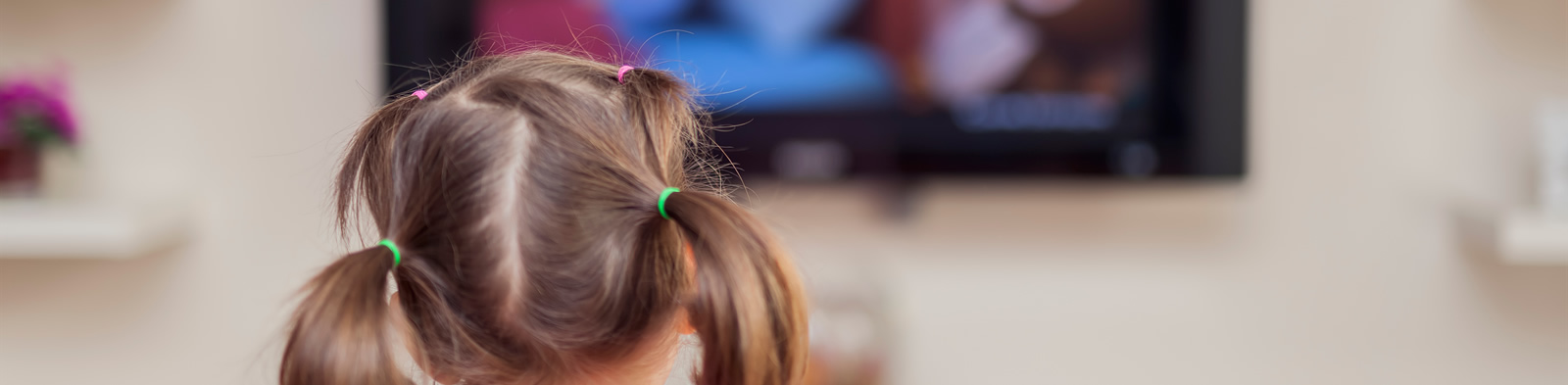 Child watching advertising on television