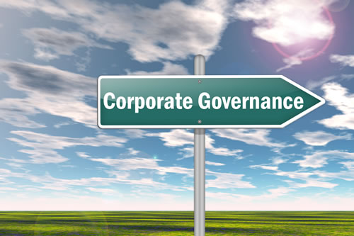 A sign pointing to Corporate Governance