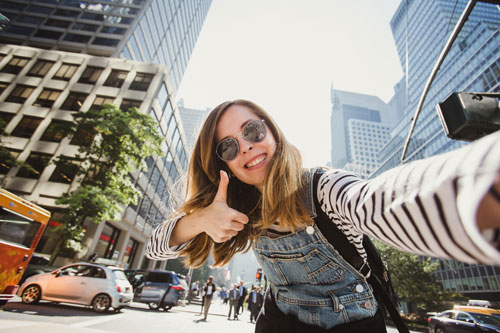 Young girl taking selfie
