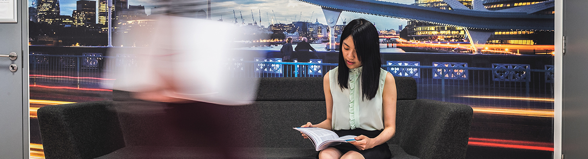 Female asian student reading a book.