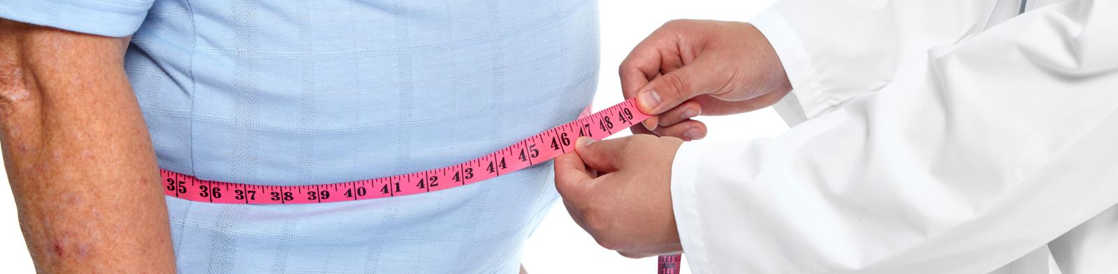 Doctor measuring patient's waist