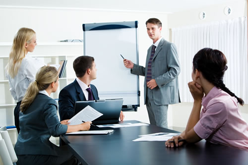 Workers in an office meeting
