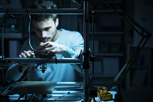 Man using 3D printer