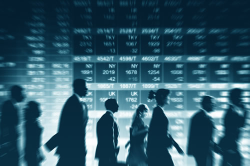 Traders against a background of share prices