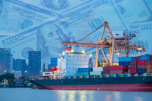 A cargo ship and a graphic of dollar bills