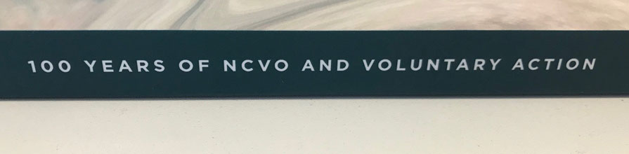 The spine of Cass researcher, Dr Justin Davis-Smith's book, 100 years of NVCO and Voluntary action