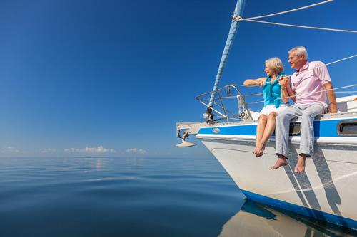 Retired couple enjoying a sailing trip