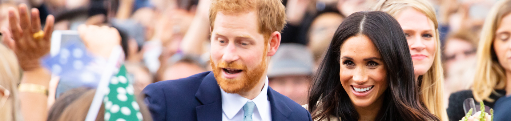 Harry and Meghan amidst a crowd