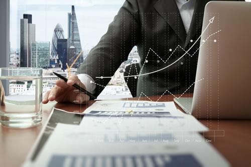 Businessman working through finances