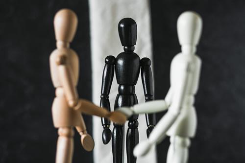 Mannequins shaking hands