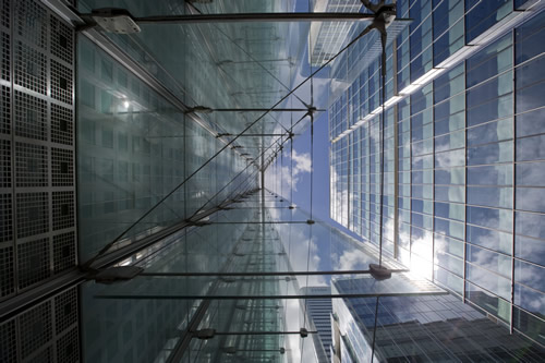 View looking up at a financial district building