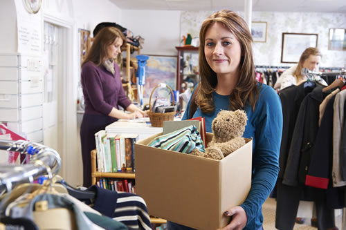 Lady donating items to a charity shop