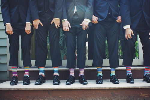 business men in suits wearing colourful socks