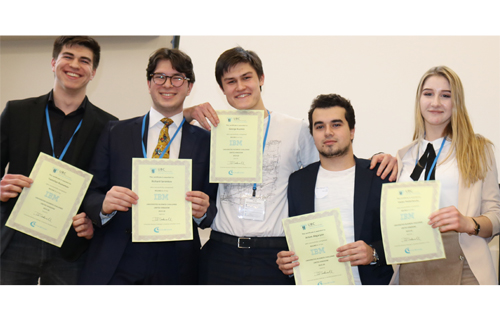 students line up with their certificates