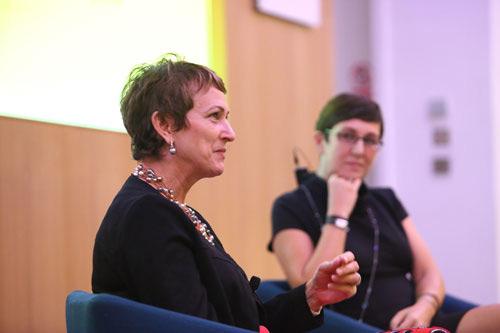 Dame Inga Beale speaking at a talk next to Dr Canan Kocabasoglu Hillmer