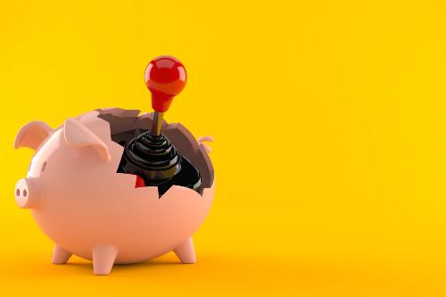 Piggy bank and joystick