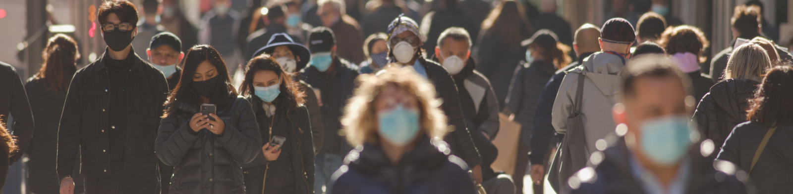 A group of people wearing masks