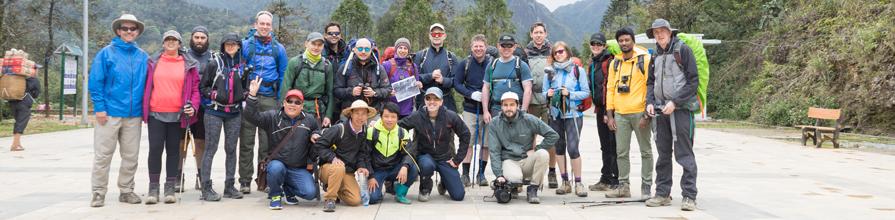 Group standing in front of Mount Fanispan in Vietnam