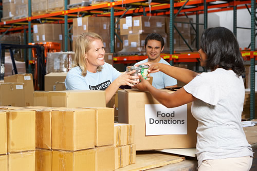 Charity workers handling donations