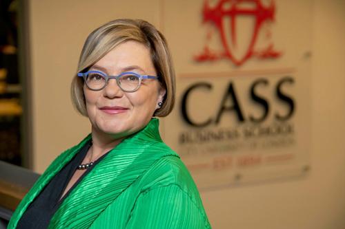 Professor Paula Jarzabkowski in front of Cass logo