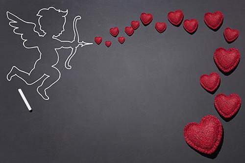 Cupid firing an arrow with hearts