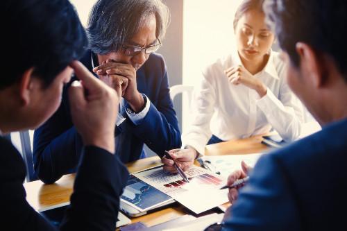 Boss chairing a staff meeting