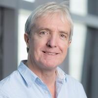 Portrait of Dr Justin Davis-Smith CBE