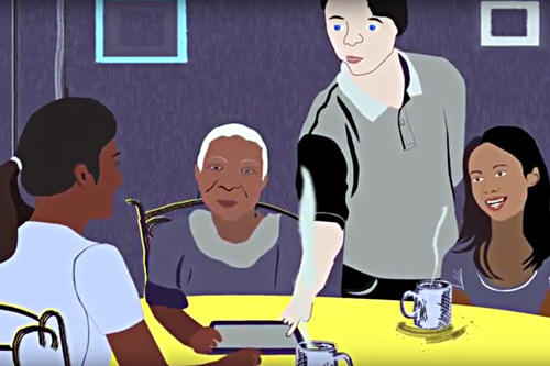 Young man serving dinner to older family
