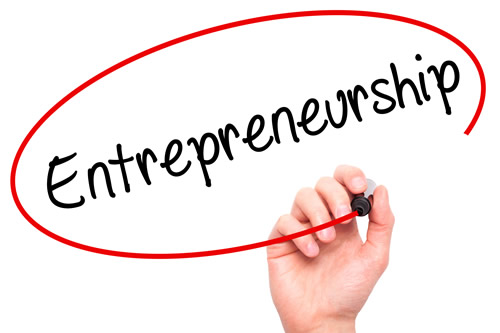 A hand writing the word Entrepreneurship