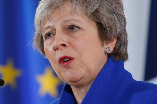 Theresa May looks in to the distance while delivering a speech.