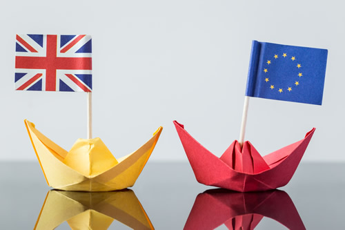 The UK and EU depicted as boats sailing away from each other