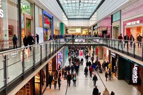 people walking through a crowded shopping centre