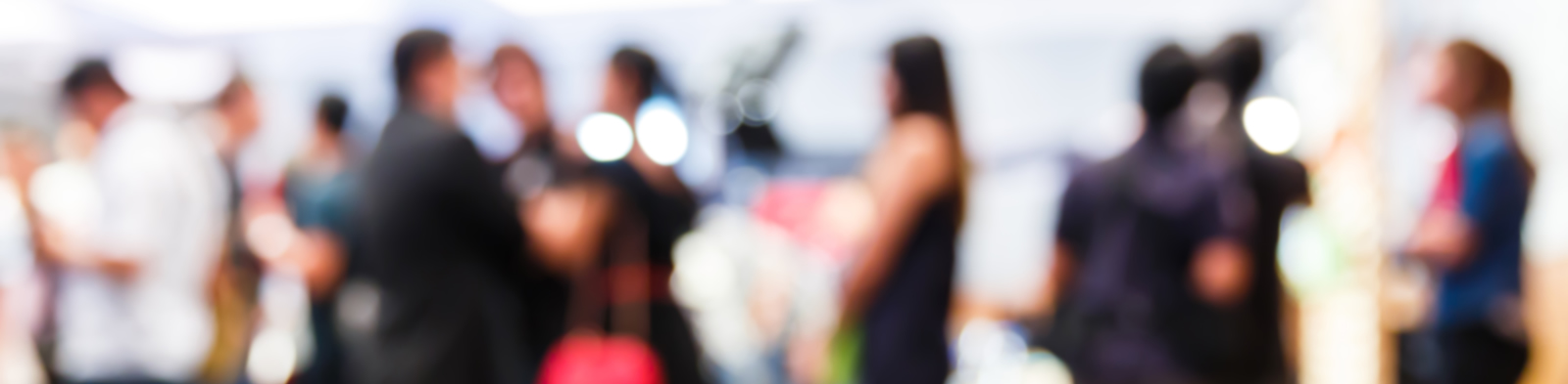 Blurred image of people mingling