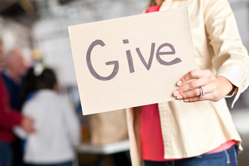 """A sign saying """"Give"""""""