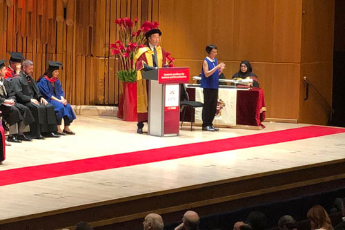 The CEO of Dow Jones, publisher of the Wall Street Journal, William Lewis delivers a speech to graduates at the 2019 Summer Graduations Ceremony at the Barbican Centre in London.