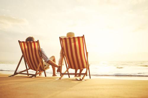 Retired couple enjoying the beach