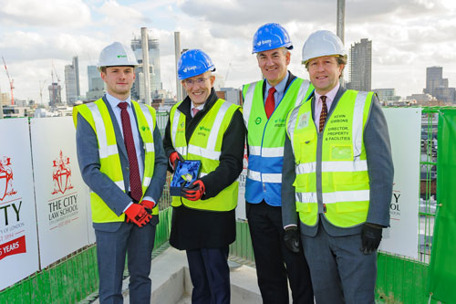 Presentation of trowel at topping out ceremony of Sebastian Street