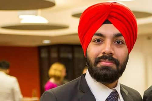 man in suit and turban smiling