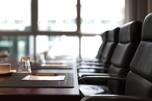 Empty leather chairs in boardroom. Corporate governance reform