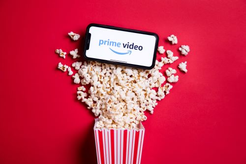 A mobile phone atop some popcorn