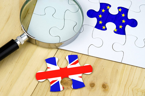 Jigsaw pieces with British and EU flags