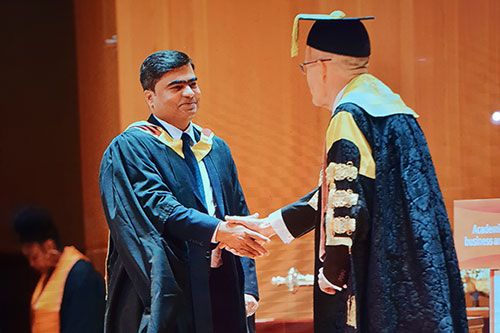 DEMBA graduate at graduation ceremony in London