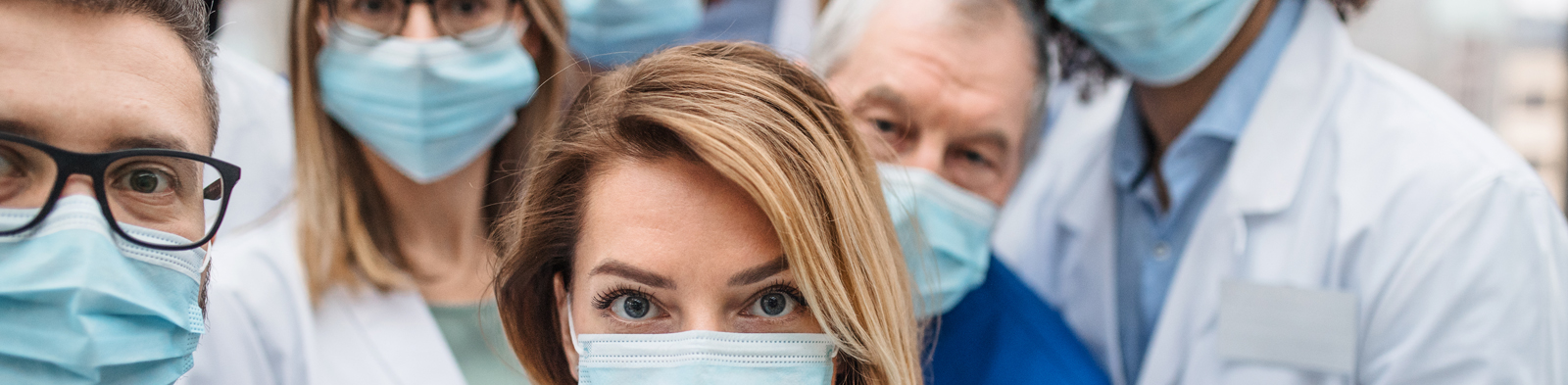 Doctors line up in surgical masks